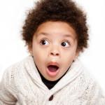 Dropped jaw open eyes shocked child isolated on white background.